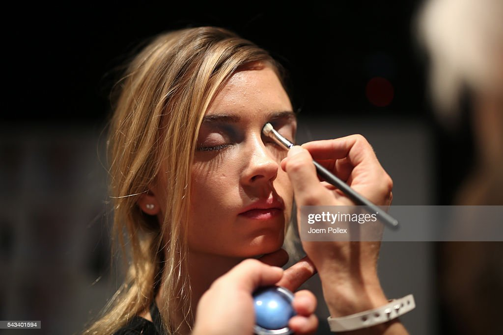 A model gets prepared backstage ahead of the Steinrohner show during the Mercedes-Benz Fashion Week Berlin Spring/Summer 2017 at Erika Hess Eisstadion on June 28, 2016 in Berlin, Germany.