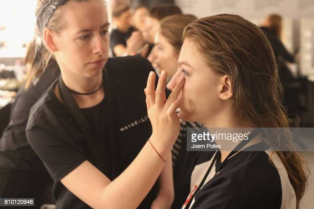 A model gets prepared backstage ahead of the Vladimir Karaleev show during the MercedesBenz Fashion Week Berlin Spring/Summer 2018 at Kaufhaus...