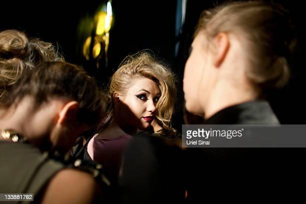 A model gets prepared backstage during a fashion show by Israeli designer '' Sugar Daddy '' during the Tel Aviv Fashion Week on November 21 2011 in...