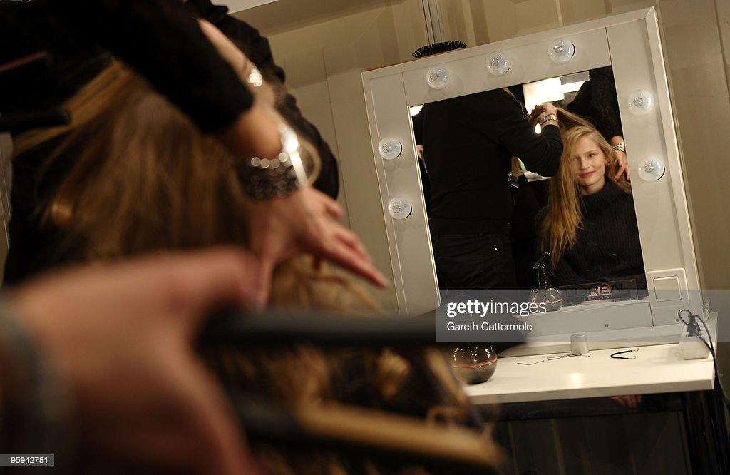 A model gets prepared prior the Strenesse Blue Fashion Show during the MercedesBenz Fashion Week Berlin Autumn/Winter 2010 at the Bebelplatz on...