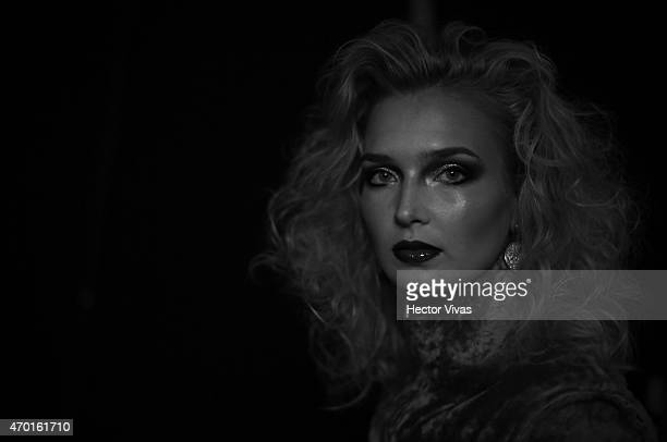 A model gets ready at the backstage during the Page Show as part of MercedesBenz Fashion Week Mexico Fall/Winter 2015 at Campo Marte on April 17 2015...