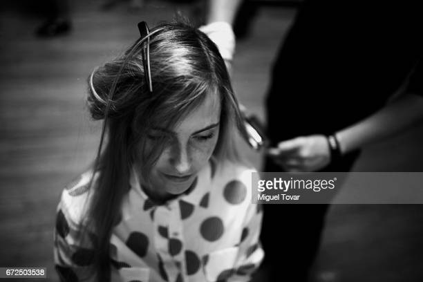 A model gets ready at the backstage during the Pineda Covalin show as part of the Mercedes Benz Fashion Week Mexico A/W 2017 at Monumento a la...