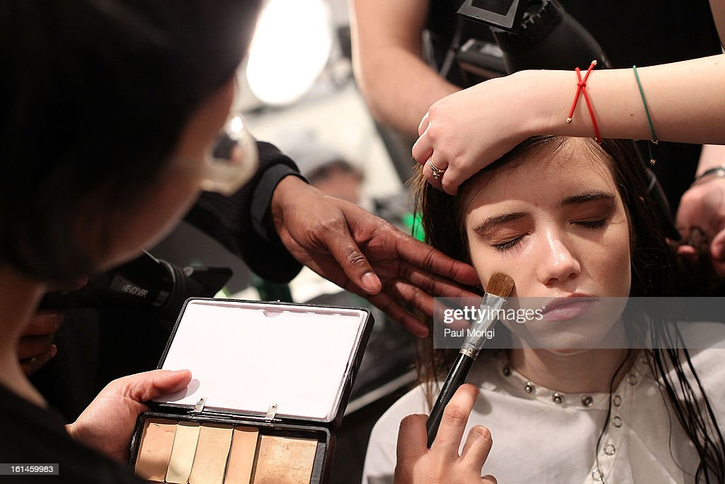 A model gets ready backstage at ICB By Prabal Gurung during Fall 2013 Mercedes-Benz Fashion Week at The Studio at Lincoln Center on February 11, 2013 in New York City.