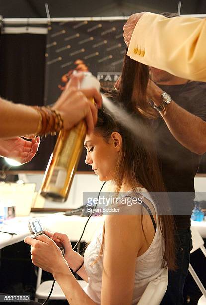 A model gets ready backstage at the Naeem Khan Spring 2006 fashion show during Olympus Fashion Week at Bryant Park September 9 2005 in New York City
