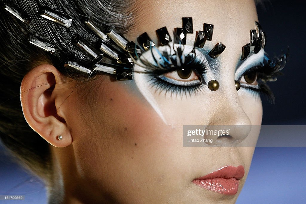 A model gets ready backstage before during the MGPIN Collection on the four th day of Mercedes-Benz China Fashion Week Autumn/Winter 2013/2014 at 751 D.PARK Workshop on March 27, 2013 in Beijing, China.