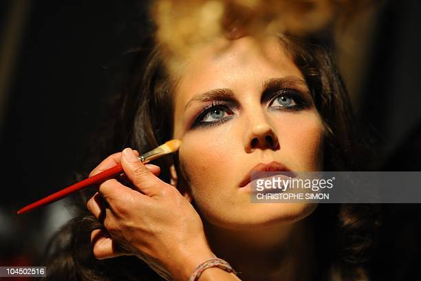 A model gets ready backstage prior the Elena Miro springsummer 2011readytowear collection on September 22 2010 during the Women's fashion week in...
