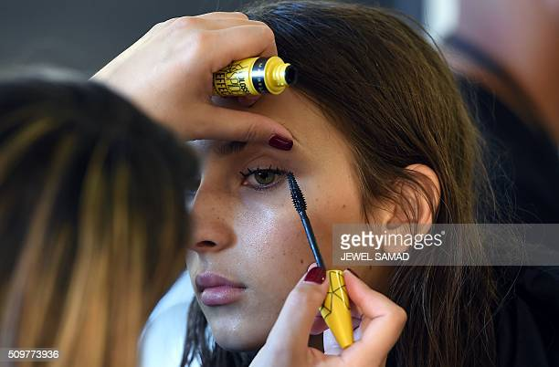 A model gets ready backstage to present Jason Wu designs during the Fall 2016 New York Fashion Week on February 12 in New York / AFP / Jewel Samad