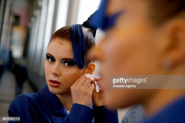 A model gets ready before she presents the 2017/2018 Fall/Winter creations of designer Dima Neu during MercedesBenz Fashion Week in Moscow Russia on...