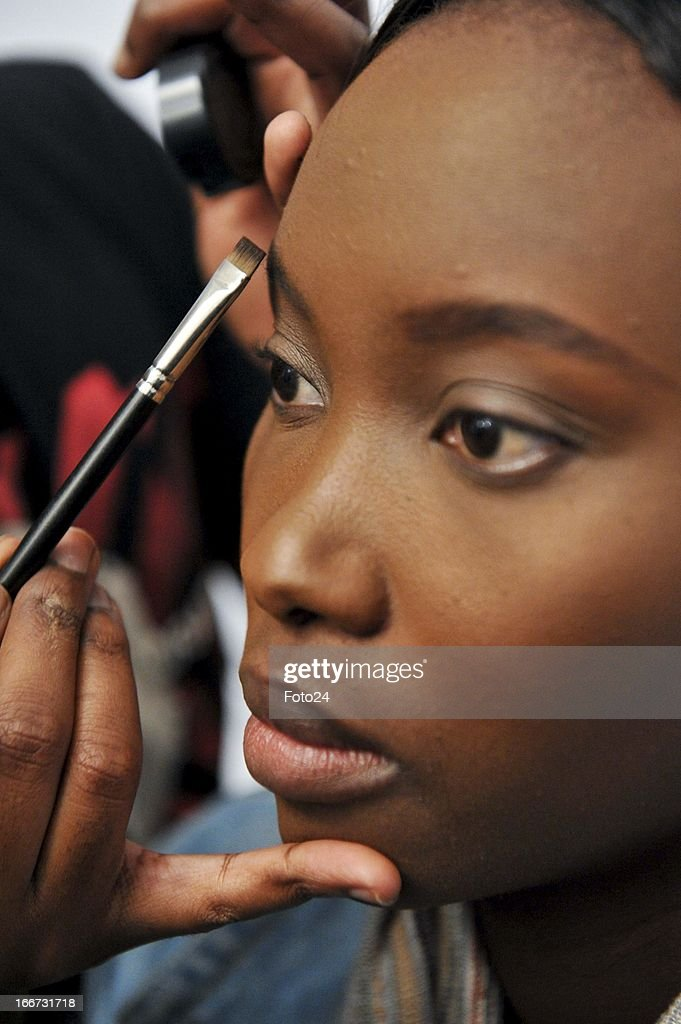 A model getting ready for the Kottin & Twille show during SA Fashion Week at the Crowne Plaza on April 12, 2013, in Johannesburg, South Africa.