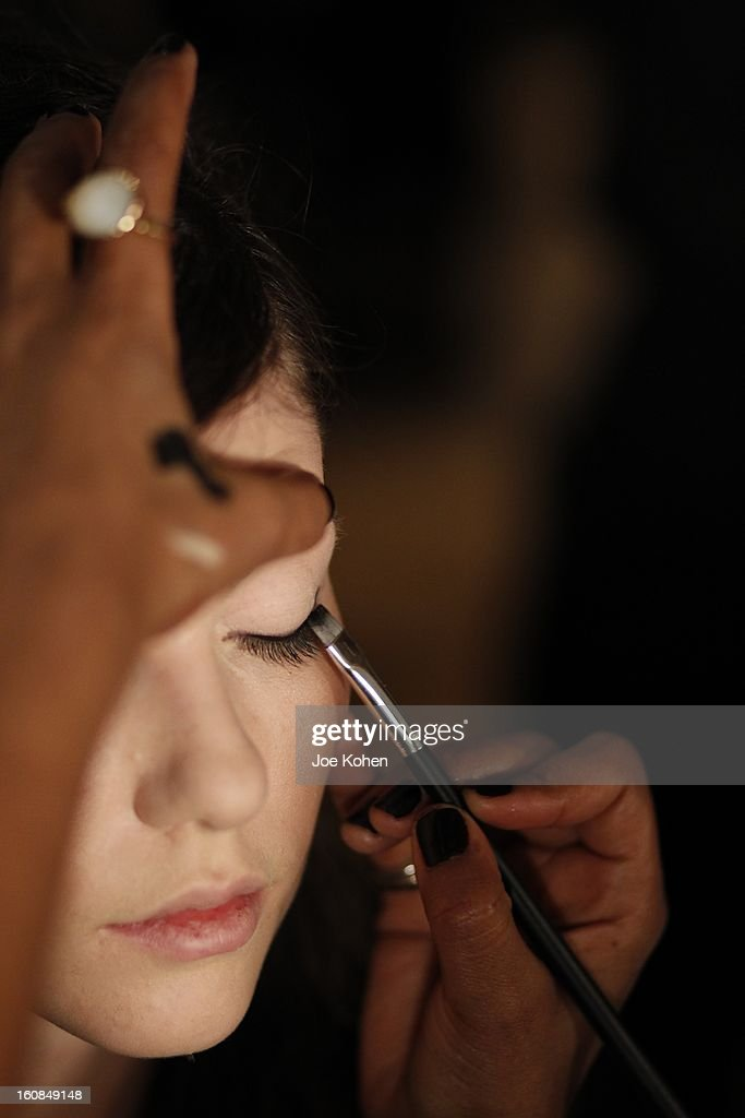 A model getting ready for the Tanya Taylor fall 2013 presentation at The Museum of Modern Art on February 6, 2013 in New York City.