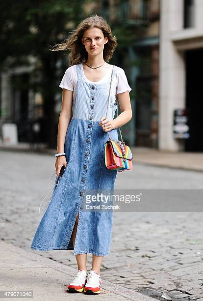 Model Gierdre Dukauskaite is seen around Noho wearing a vintage dress Valentino bag and Nike sneakers on June 30 2015 in New York City