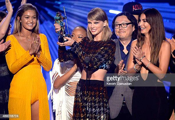 Model Gigi Hadid actress Serayah recording artist Taylor Swift director Joseph Kahn model Lily Aldridge accept the Video of the Year award for 'Bad...