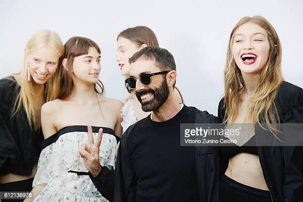 Model Gigi Hadid and Designer Giambattista Valli pose backstage prior the Giambattista Valli show as part of the Paris Fashion Week Womenswear...