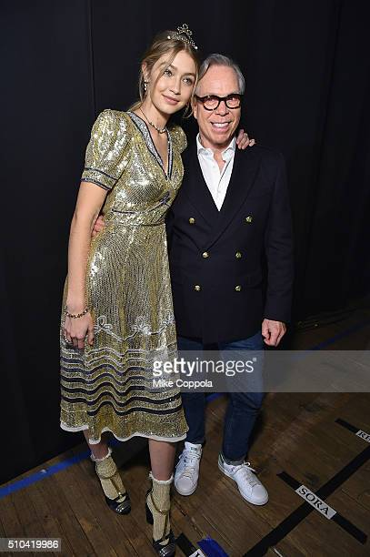 Model Gigi Hadid and designer Tommy Hilfiger pose backstage at the Tommy Hilfiger Women's Fall 2016 show during New York Fashion Week The Shows at...