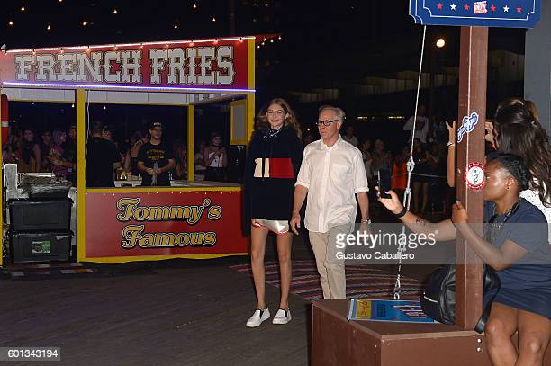 Model Gigi Hadid and Designer Tommy Hilfiger walk the runway at the #TOMMYNOW Women's Fashion Show during New York Fashion Week at Pier 16 on...