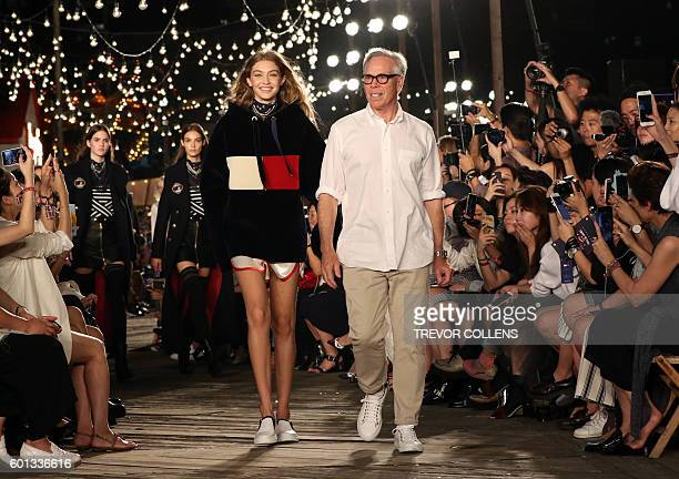 Model Gigi Hadid and Designer Tommy Hilfiger wave to the audience during the Tommy Hilfiger fall 2016 collection presented at New York Fashion Week...