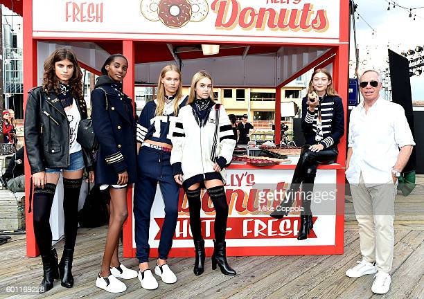 Model Gigi Hadid and fashion designer Tommy Hilfiger pose with models during the #TOMMYNOW Women's Fashion Show during New York Fashion Week at Pier...