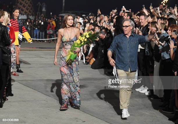 Model Gigi Hadid and fashion designer Tommy Hilfiger walk the runway at the TommyLand Tommy Hilfiger Spring 2017 Fashion Show on February 8 2017 in...