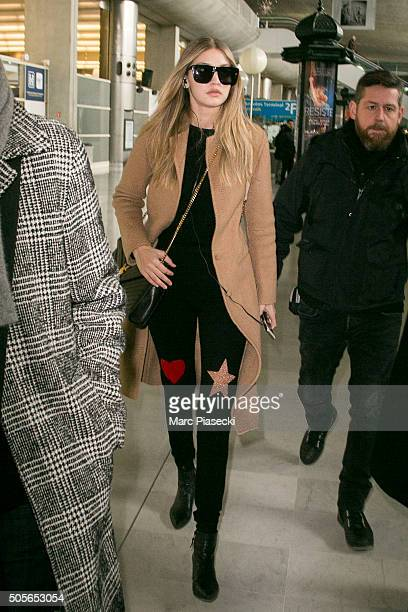 Model Gigi Hadid arrives at CharlesdeGaulle airport on January 19 2016 in Paris France