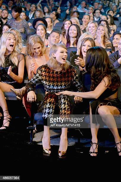 Model Gigi Hadid model Karlie Kloss actress Mariska Hargitay and recording artist Selena Gomez congratulate recording artist Taylor Swift after she...