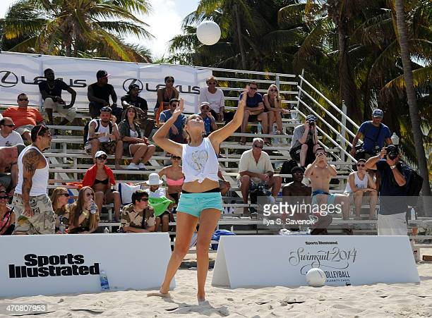 Model Gigi Hadid participates in Sports Illustrated Swimsuit 2014 Beach VolleyballModels Celebrity Chefs on February 20 2014 in Miami Beach Florida