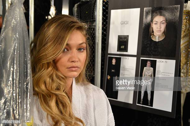 Model Gigi Hadid prepares backstage at the BALMAIN X HM Collection Launch at 23 Wall Street on October 20 2015 in New York City