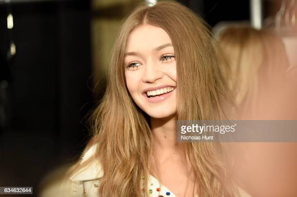 Model Gigi Hadid prepares backstage for the Jeremy Scott collection during New York Fashion Week The Shows at Gallery 1 Skylight Clarkson Sq on...