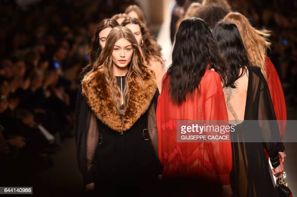 TOPSHOT Model Gigi Hadid present a creation for fashion house Fendi during the Women's Fall/Winter 2017/2018 fashion week in Milan on February 23...