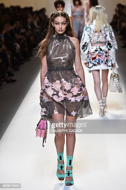 Model Gigi Hadid presents a creation for fashion house Fendi during the 2017 Women's Spring / Summer collections shows at Milan Fashion Week on...