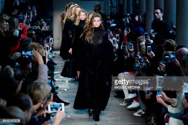 TOPSHOT Model Gigi Hadid presents a creation for fashion house Max Mara during the Women's Fall/Winter 2017/2018 fashion week in Milan on February 23...