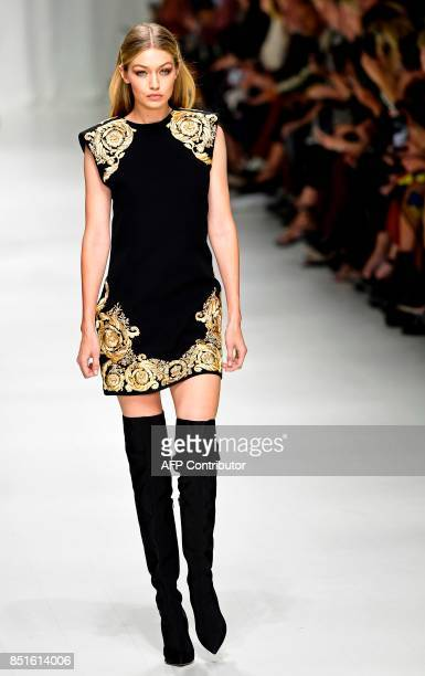 Model Gigi Hadid presents a creation for fashion house Versace during the Women's Spring/Summer 2018 fashion shows in Milan on September 22 2017 /...