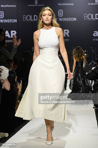 Model Gigi Hadid walks during the fashion show runway during amfAR's 22nd Cinema Against AIDS Gala Presented By Bold Films And Harry Winston at Hotel...