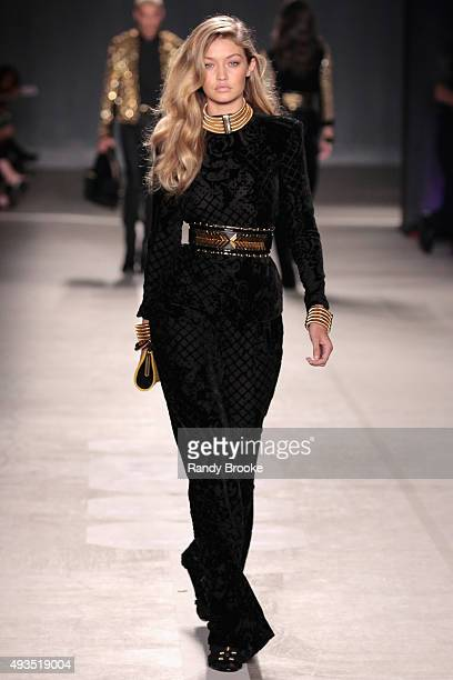 Model Gigi Hadid walks the runway at the BALMAIN X HM Collection Launch at 23 Wall Street on October 20 2015 in New York City