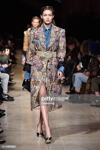 Model Gigi Hadid walks the runway at the Miu Miu Autumn Winter 2016 fashion show during Paris Fashion Week on March 9 2016 in Paris France