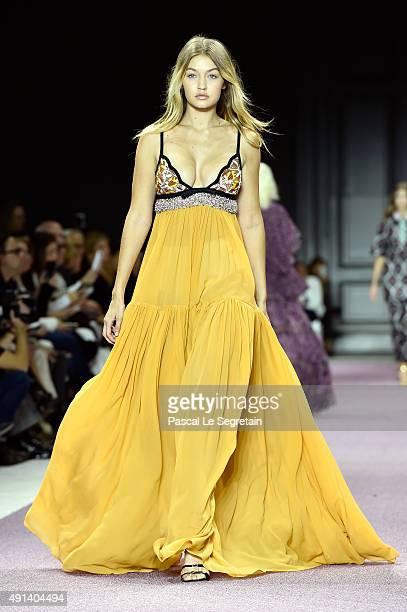 Model Gigi Hadid walks the runway during the Giambattista Valli show as part of the Paris Fashion Week Womenswear Spring/Summer 2016 on October 5...