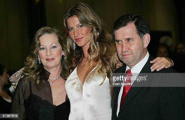 Model Gisele Bundchen and her parents attend the 'Taxi' film premiere featuring a taxi cab drivein at the Jacob Javits Center October 3 2004 in New...