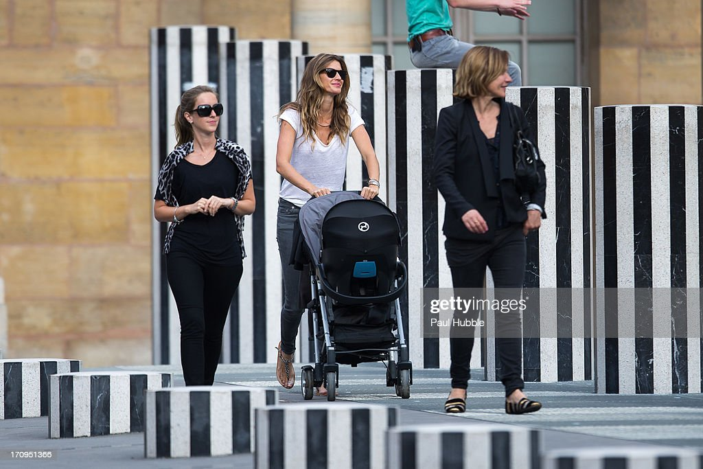 Model Gisele Bundchen (C) and her sister Rafaela Bundchen (L) are sighted at the Palais Royal on June 20, 2013 in Paris, France.