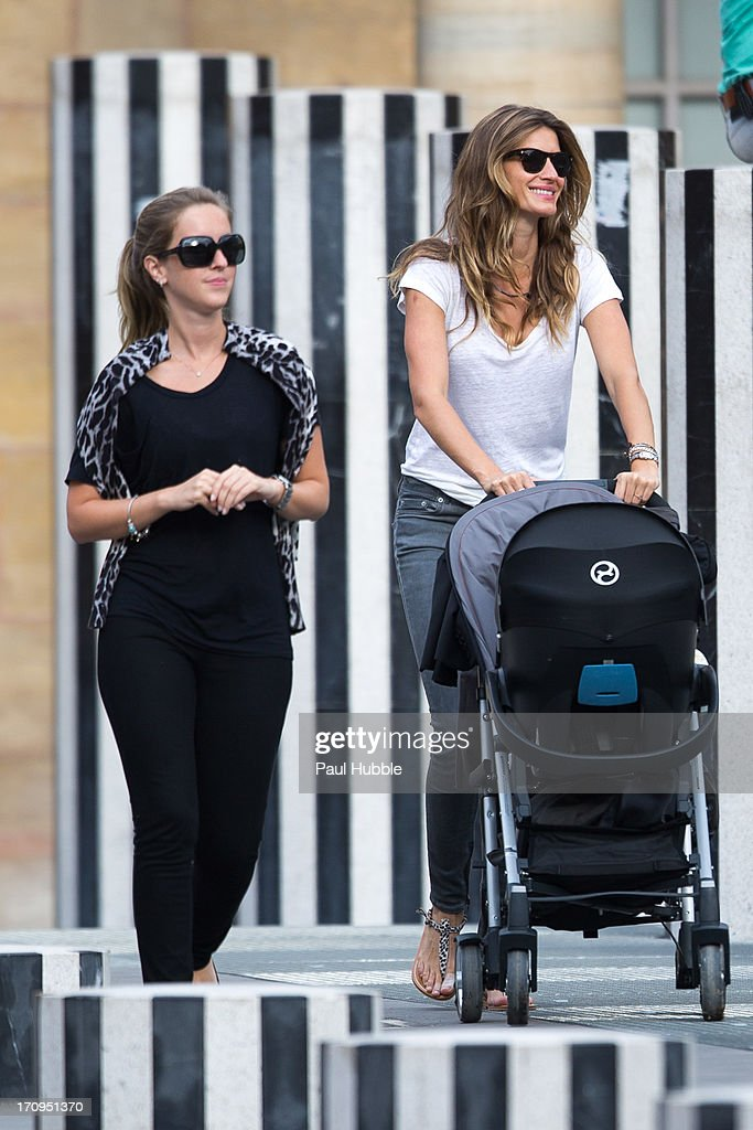 Model <a gi-track='captionPersonalityLinkClicked' href=/galleries/search?phrase=Gisele+Bundchen&family=editorial&specificpeople=201815 ng-click='$event.stopPropagation()'>Gisele Bundchen</a> (R) and her sister Rafaela Bundchen (L) are sighted at the Palais Royal on June 20, 2013 in Paris, France.