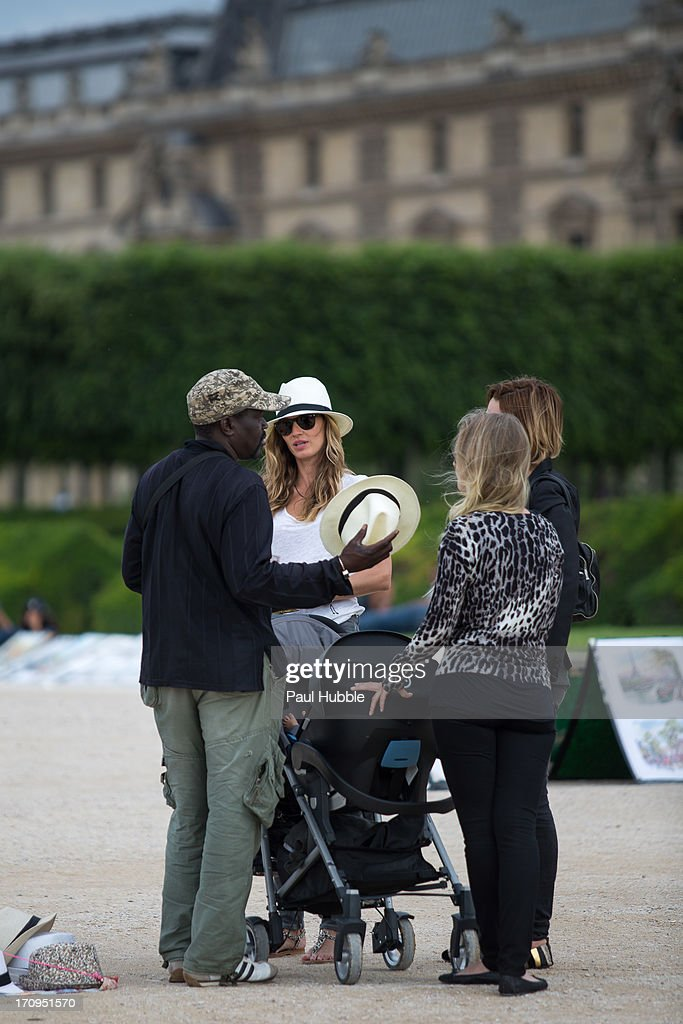Model Gisele Bundchen (L) and her sister Rafaela Bundchen (R) are sighted in the 'Tuileries' gardens on June 20, 2013 in Paris, France.