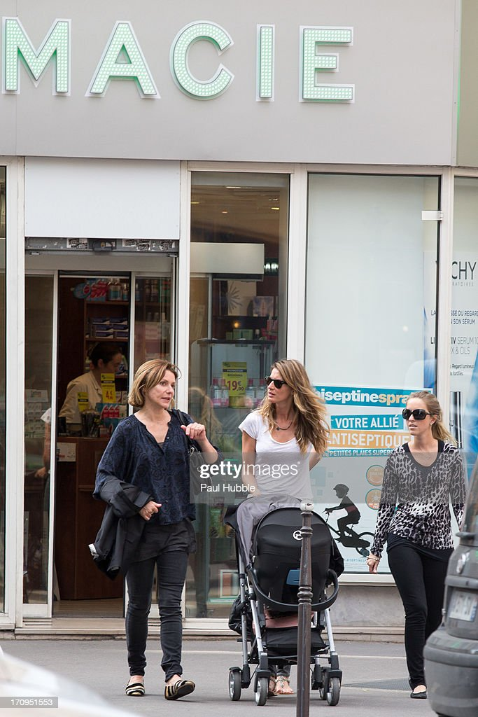 Model Gisele Bundchen (C) and her sister Rafaela Bundchen (R) are sighted on the 'Rue Saint Honore' on June 20, 2013 in Paris, France.
