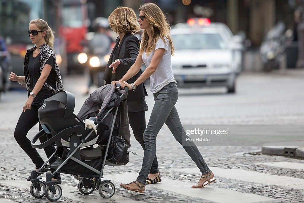 Model <a gi-track='captionPersonalityLinkClicked' href=/galleries/search?phrase=Gisele+Bundchen&family=editorial&specificpeople=201815 ng-click='$event.stopPropagation()'>Gisele Bundchen</a> (R) and her sister Rafaela Bundchen (L) are sighted on the 'Place Colette' on June 20, 2013 in Paris, France.