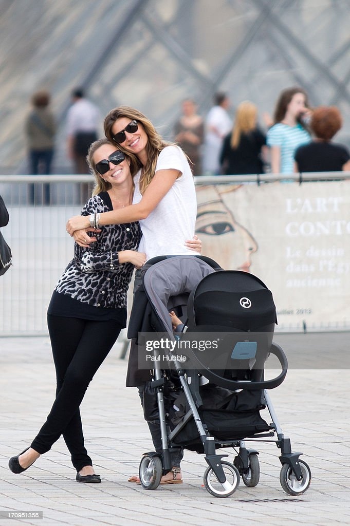 Model <a gi-track='captionPersonalityLinkClicked' href=/galleries/search?phrase=Gisele+Bundchen&family=editorial&specificpeople=201815 ng-click='$event.stopPropagation()'>Gisele Bundchen</a> and her sister Rafaela Bundchen are sighted near the 'Louvre' museum on June 20, 2013 in Paris, France.