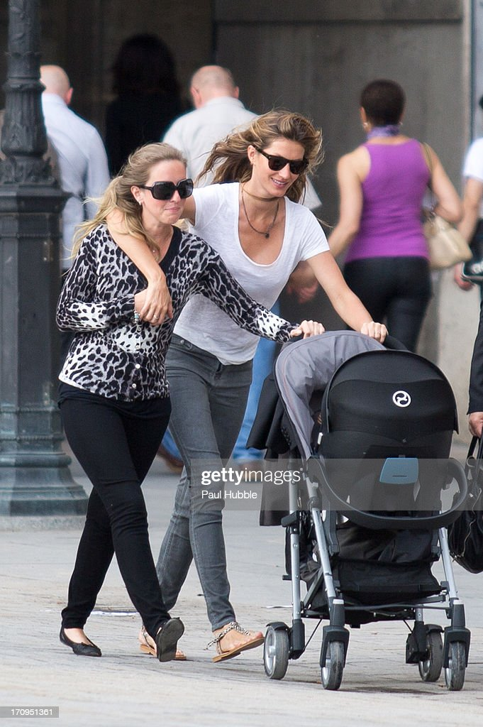 Model <a gi-track='captionPersonalityLinkClicked' href=/galleries/search?phrase=Gisele+Bundchen&family=editorial&specificpeople=201815 ng-click='$event.stopPropagation()'>Gisele Bundchen</a> (R) and her sister Rafaela Bundchen (L) are sighted near the 'Louvre' museum on June 20, 2013 in Paris, France.