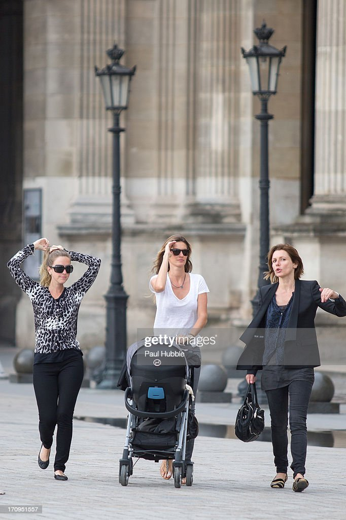Model Gisele Bundchen (C) and her sister Rafaela Bundchen (L) are sighted near the 'Louvre' museum on June 20, 2013 in Paris, France.