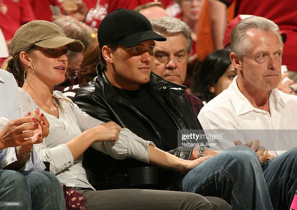 Model Gisele Bundchen and New England Patriots quarterback Tom Brady sit courtside for Game Four of the NBA Finals between the Cleveland Cavaliers and the San Antonio Spurs at the Quicken Loans Arena on June 14, 2007 in Cleveland, Ohio.