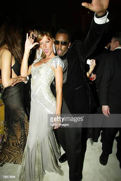 Model Gisele Bundchen and Sean 'P Diddy' Combs attend the Costume Institute Benefit Gala sponsored by Gucci April 28 2003 at The Metropolitan Museum...