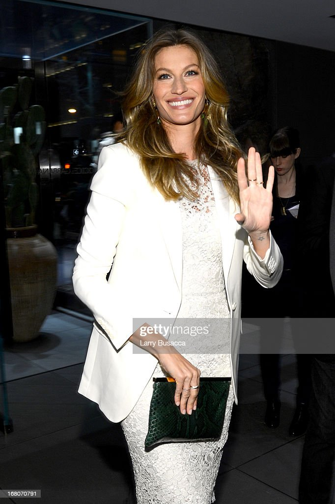 Model <a gi-track='captionPersonalityLinkClicked' href=/galleries/search?phrase=Gisele+Bundchen&family=editorial&specificpeople=201815 ng-click='$event.stopPropagation()'>Gisele Bundchen</a> attends Dolce&Gabbana, along with Giovanna Battaglia, celebrate the opening of the 5th Avenue Flagship Boutique on May 4, 2013 in New York City.