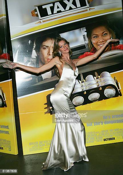 Model Gisele Bundchen attends the 'Taxi' film premiere featuring a taxi cab drivein at the Jacob Javits Center October 3 2004 in New York City