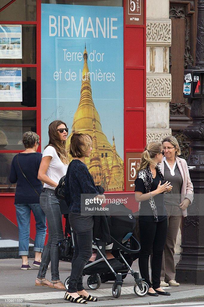 Model Gisele Bundchen (L) is sighted on the 'Avenue de l'Opera' on June 20, 2013 in Paris, France.