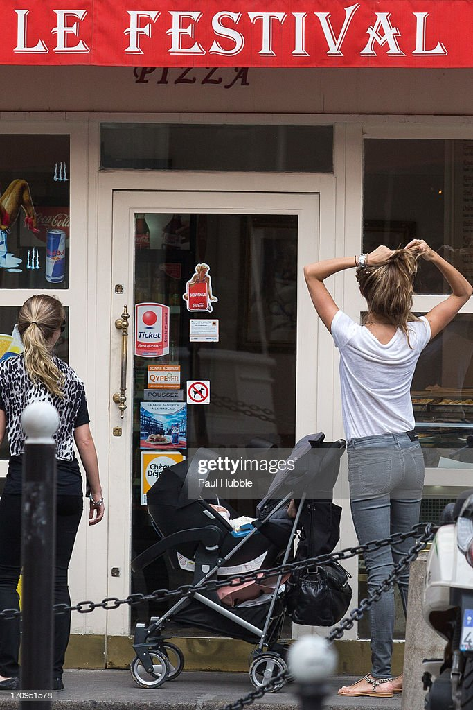 Model Gisele Bundchen (R) is sighted on the 'Rue Saint Honore' on June 20, 2013 in Paris, France.